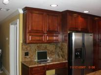 Kitchen remodel in New Luxury Home with Island, Sink, Granite, Quartz, Tile, Cabinets, and Hardwood Floors